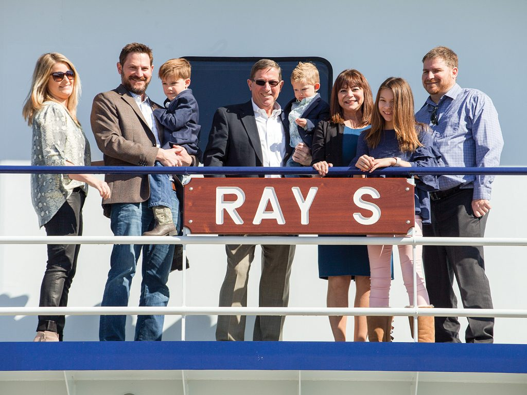 Ray Sick, center, with family aboard the newly christened mv. Ray S.