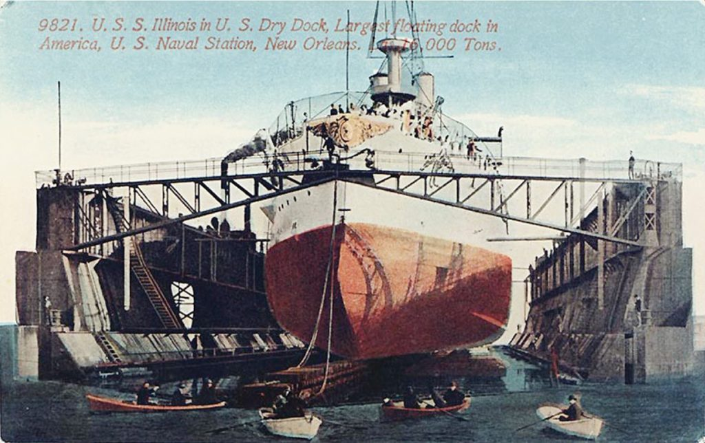 Vintage postcard showing battleship USS Illinois in drydock at Algiers, 1902.