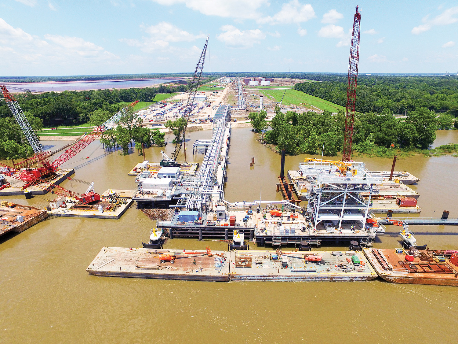 Massman completed the construction of five over-the-river structures at Pin Oak Terminal's first dock in Mt. Airy, La. The 900-foot dock is capable of loading Suezmax vessels and has up to six barge berths at Mile 144.1 on the Lower Mississippi River. (Photo courtesy of Massman Construction Company)