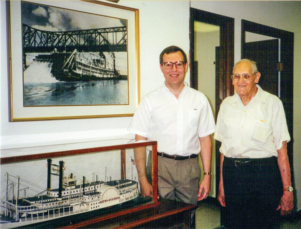 Student and mentor: Keith Norrington and James V. Swift, business manager and Old Boat Columnist, in the office of The Waterways Journal with the model of the City of St. Louis, July 1995.