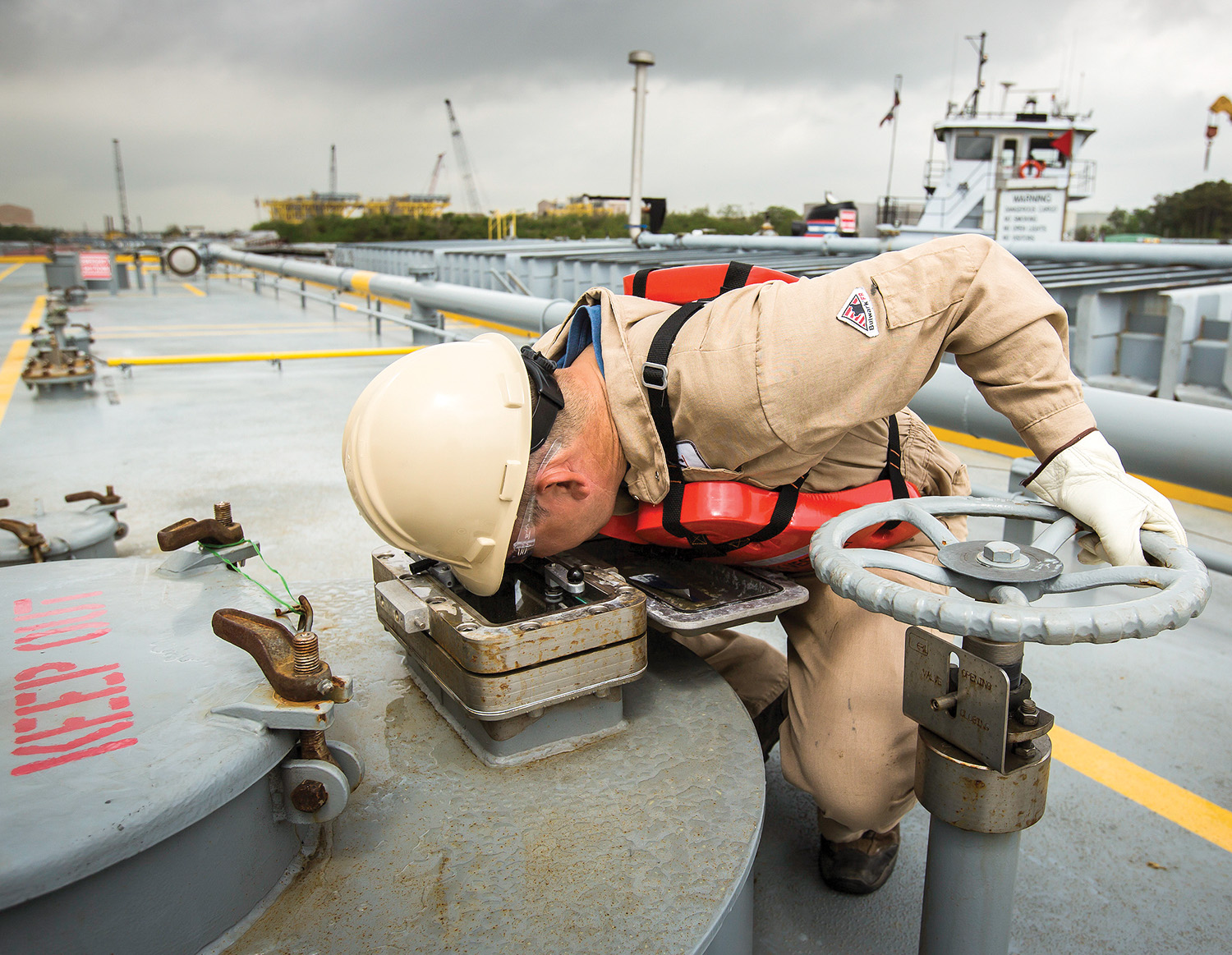 PSC Tankerman Robert Hopper monitors the flow of product into a cargo tank.(Photo courtesy of Petroleum Service Corporation)