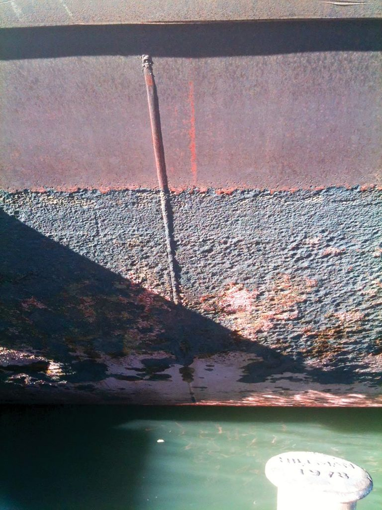 R&D Associates has seen a surge in damaged barges at its facility this year due to heavy ice floes and flooding on the Ohio River. A heavy layer of rust scale is all that protects an older barge's steel hull. When thick ice gouges away at the rust, the barge is susceptible to leaks as the ice can crush or tear into its thin plate.