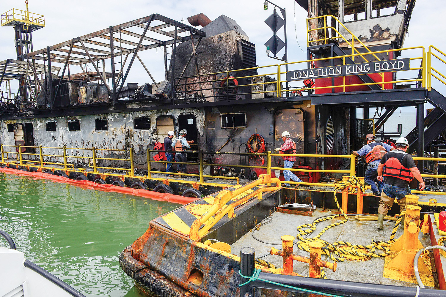Crews assess damage to burned out dredge Jonathon King Boyd. (U.S. Coast Guard photo by Petty Officer 1st Class Kelly Parker)