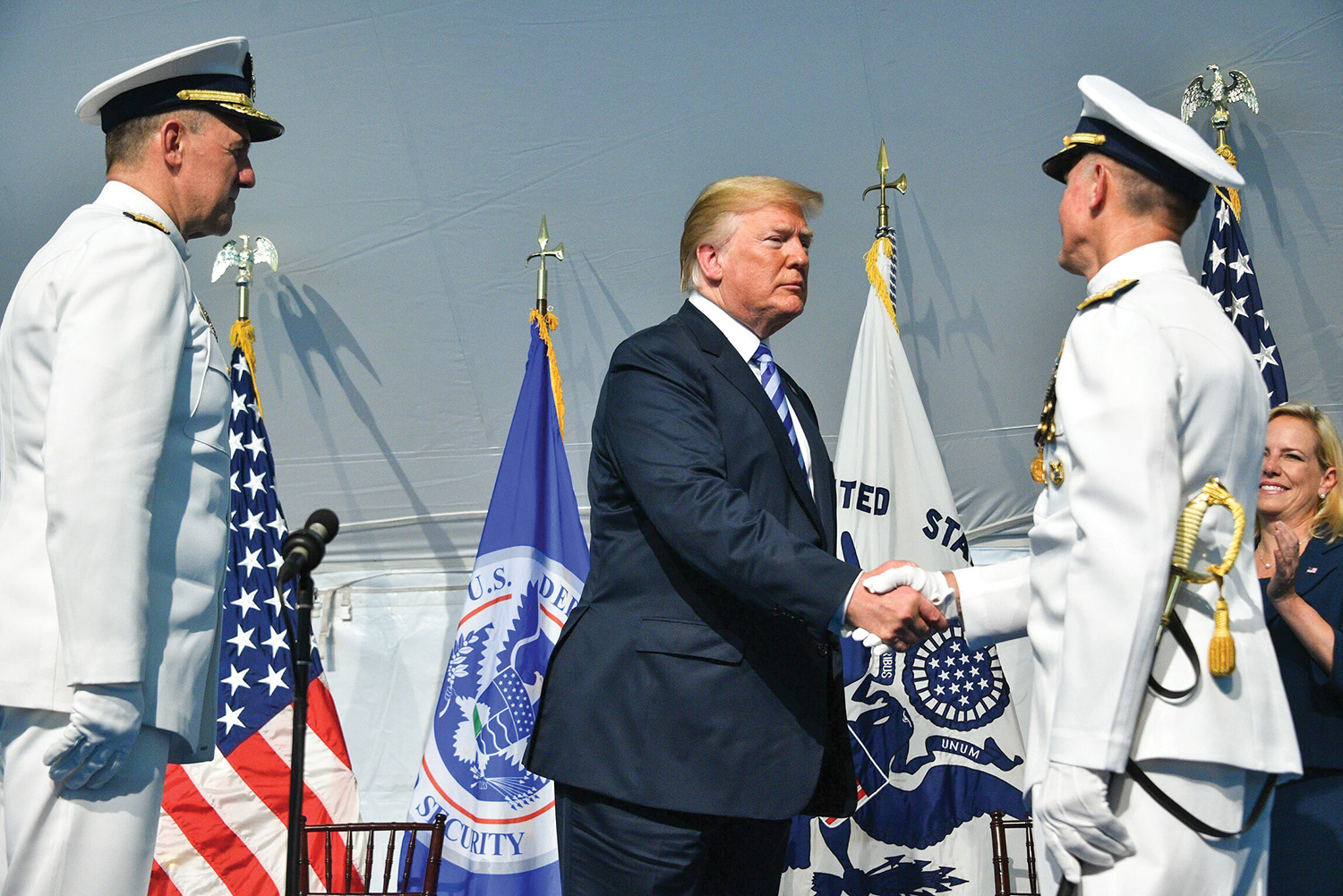 President Donald Trump congratulates Adm. Paul Zukunft during a change of command ceremony at Coast Guard Headquarters in Washington, D.C., June 1. During the ceremony Adm. Karl Schultz (left) relieved Zukunft to become the 26th commandant of the Coast Guard. (—U.S. Coast Guard photo by Petty Officer 1st Class Patrick Kelley.)