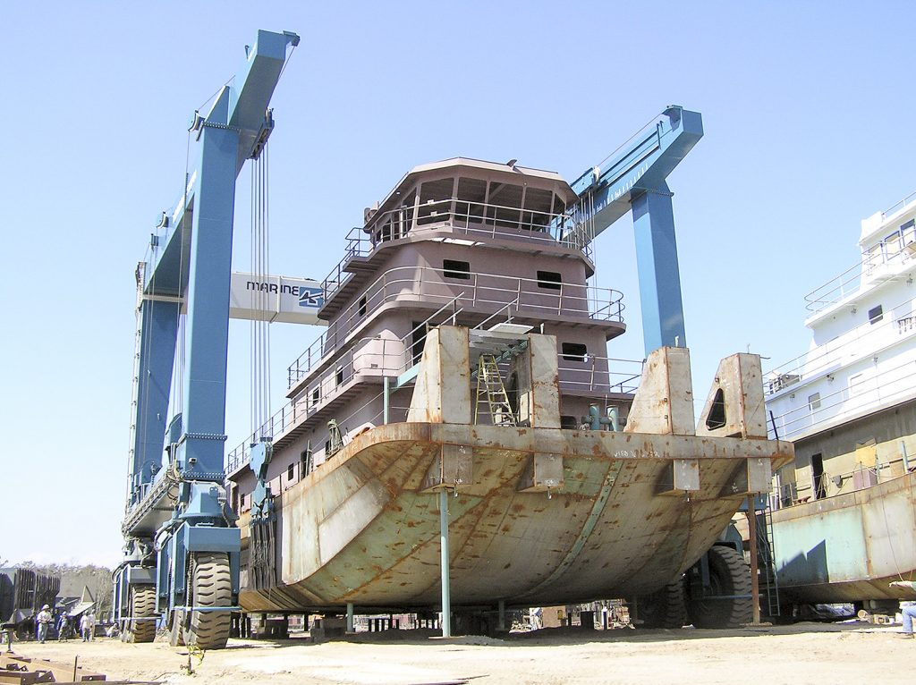 A steel towboat built by Horizon Shipbuilding on the 660-ton Travelift at Metal Shark's newly-acquired Alabama Shipyard. (Photo courtesy of Metal Shark)