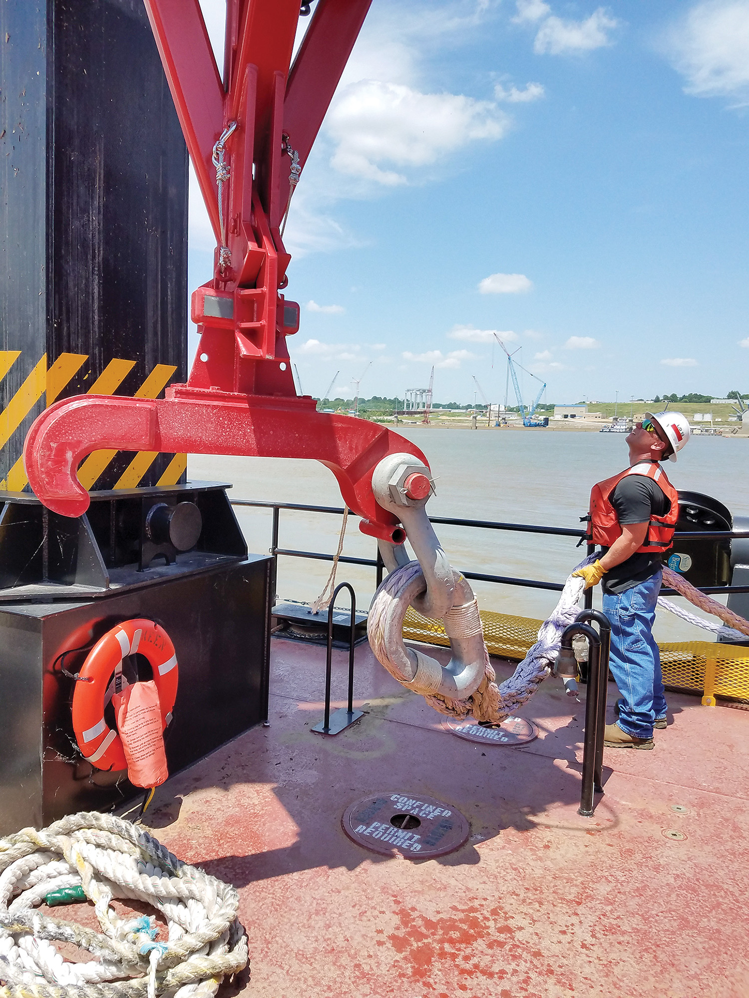 Corps employees continue training with and testing the new wicket lifter Keen at Olmsted Locks and Dam. The equipment will allow the Corps to lift the wickets at the dam and hold pool for safer navigation.
