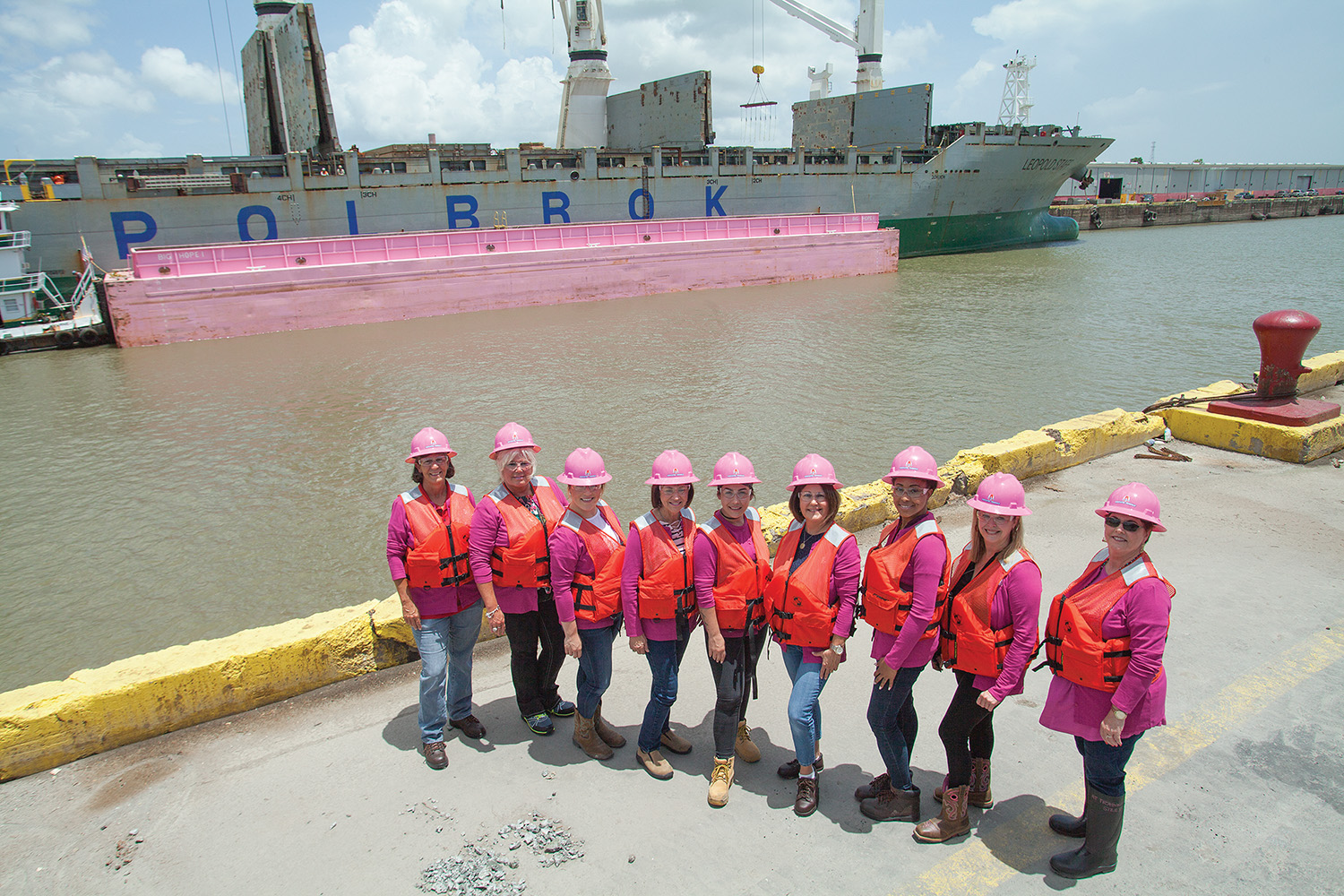 The ladies of Associated Terminals gather for a photo shoot in front of the barge Big Hope 1. (Photo by Frank McCormack)