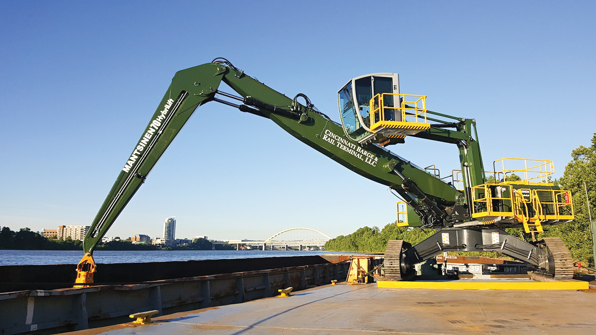 The Mantsinen 70R material handler, newly installed at Cincinnati Barge & Rail Terminal, has a maximum reach of 79 feet and is equipped with Tier 4 emissions-control technology.