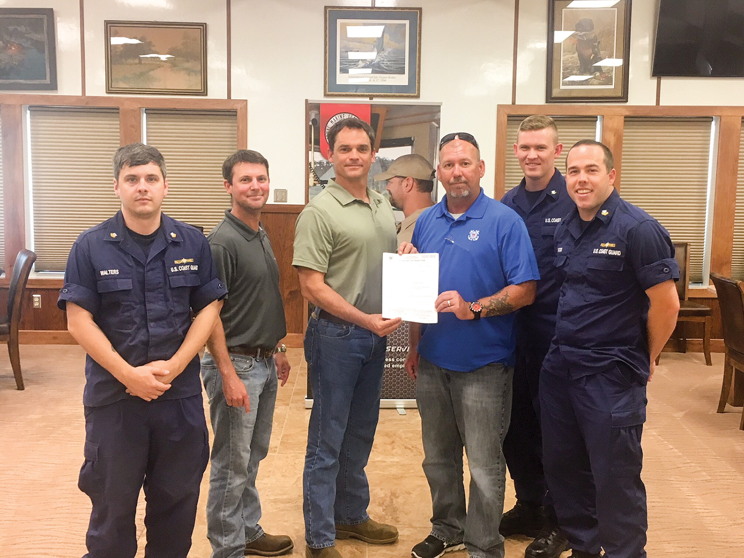 From left are: Coast Guard Petty Officer Andrew Walters; Cenac Compliance Manager Dustin Walker, Cenac Safety Manager Tim Moore; Jeff Scott, also with Cenac; Coast Guard Petty Officer Joshua Mull and Coast Guard Petty Officer Cory Basso.