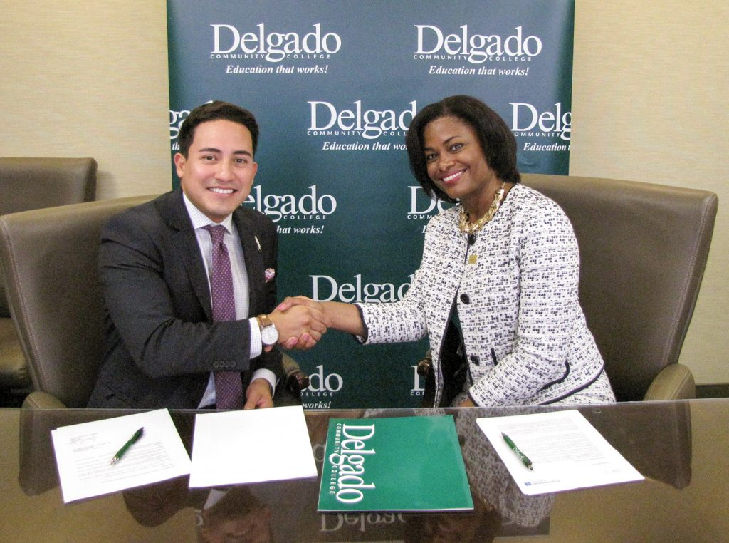 Copa Airlines Sales Executive Ernesto Posados (left) and Delgado Community College Chancellor Joan Davis formalize the new partnership between their organizations to provide students traveling to or from Central and South America and the Caribbean with special airfares.