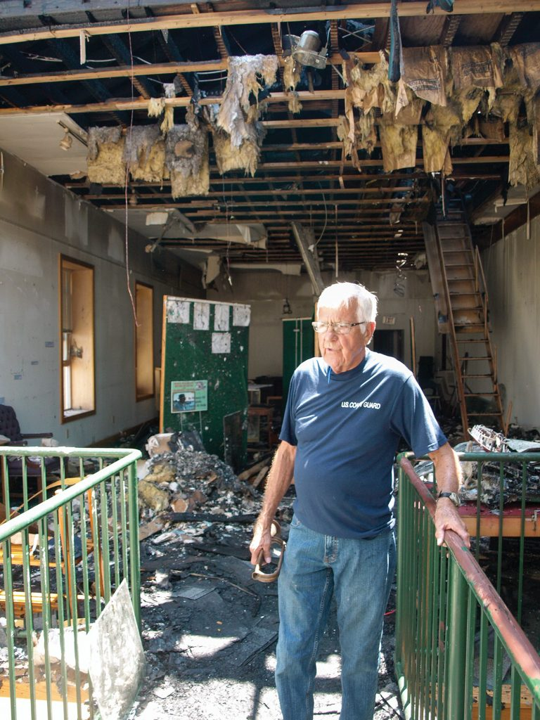 Jack Fowler shows water, ash and fire damage on the museum's second floor, which housed the museum's offices, library, towboat pilot simulators and various displays. (Photo by Jim Ross)