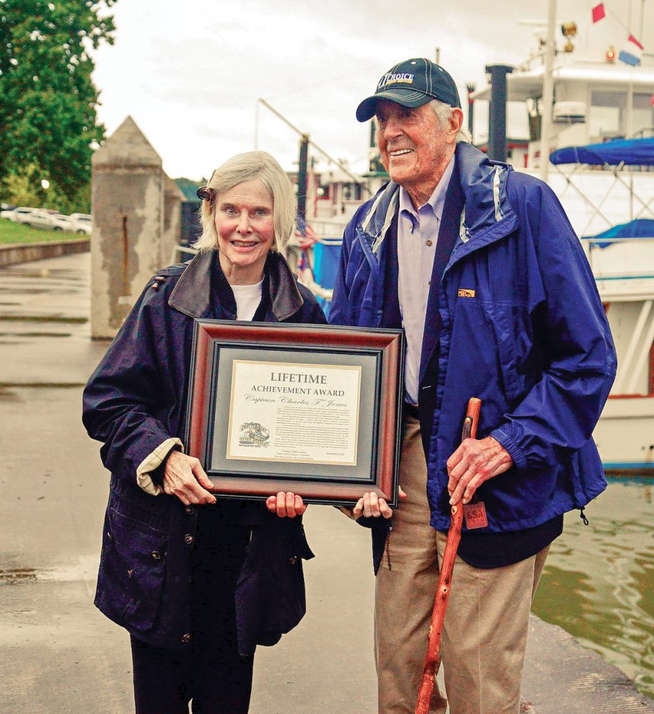 Mary Ellen and Charles T. Jones with Jones' Lifetime Achievement Award from the Point Pleasant River Museum and Learning Center.