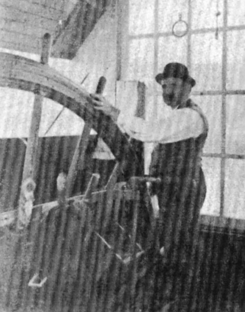 A faded photo of Capt. Ben Stout at the wheel of the Oakland.(Keith Norrington collection)