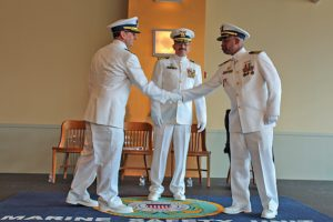 Cmdr. Aaron Demo relieved Cmdr. Leon McClain Jr. as the commanding officer of Coast Guard Marine Safety Unit Pittsburgh during a change of command ceremony at the Heinz History Center in Pittsburgh June 27. (Coast Guard photo by Lt. Shawn Simeral)