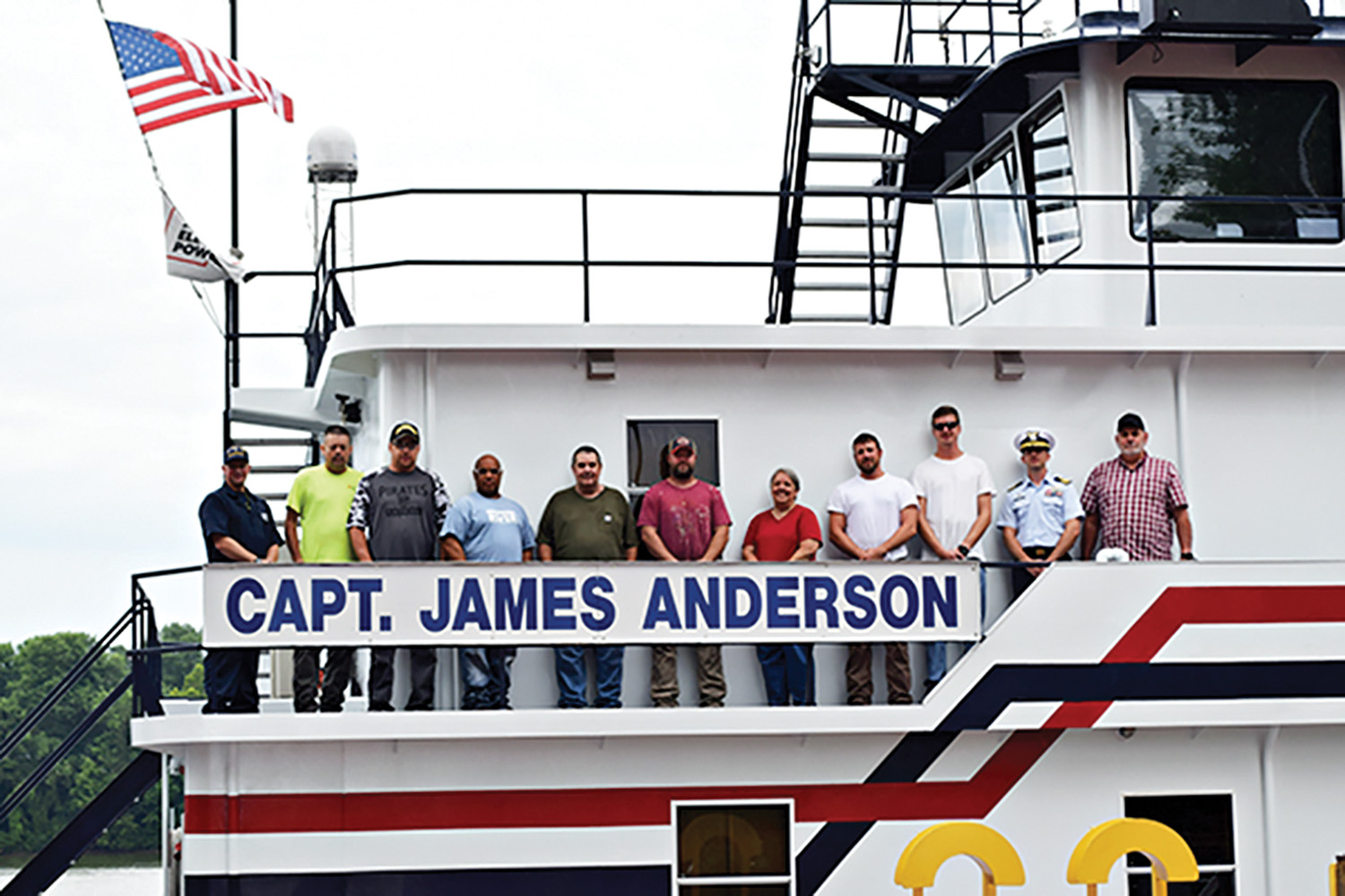 The crew of the mv. Capt. James Anderson celebrates receiving a Certificate of Inspection (COI) from the U.S. Coast Guard. From left to right is Chris Blank with the Coast Guard, Dale Nedrow, Danny Marr, Mike Rogers, Bill Null, Matt Rieger, Juanita Landes, Jonathan Jordan, James Northup, Coast Guard Cmdr. Paul Mangini and Troy Akers. (Photo by Dee Harbrecht)