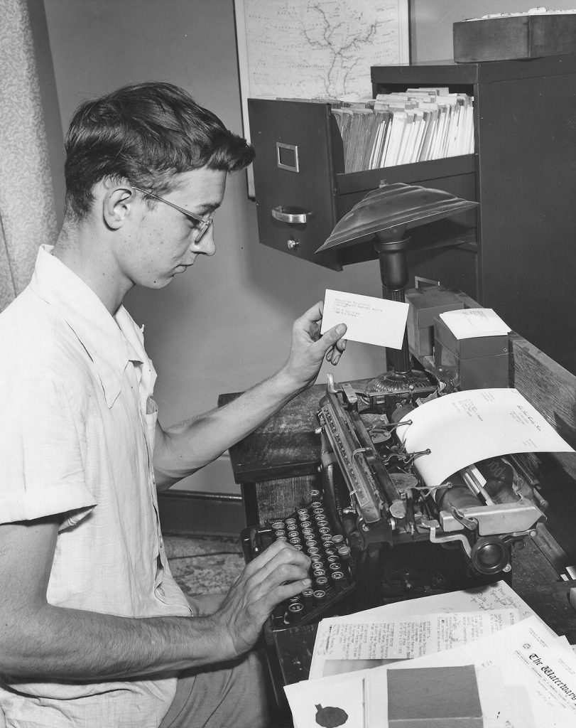 A young Dan Owen works on his towboat database.