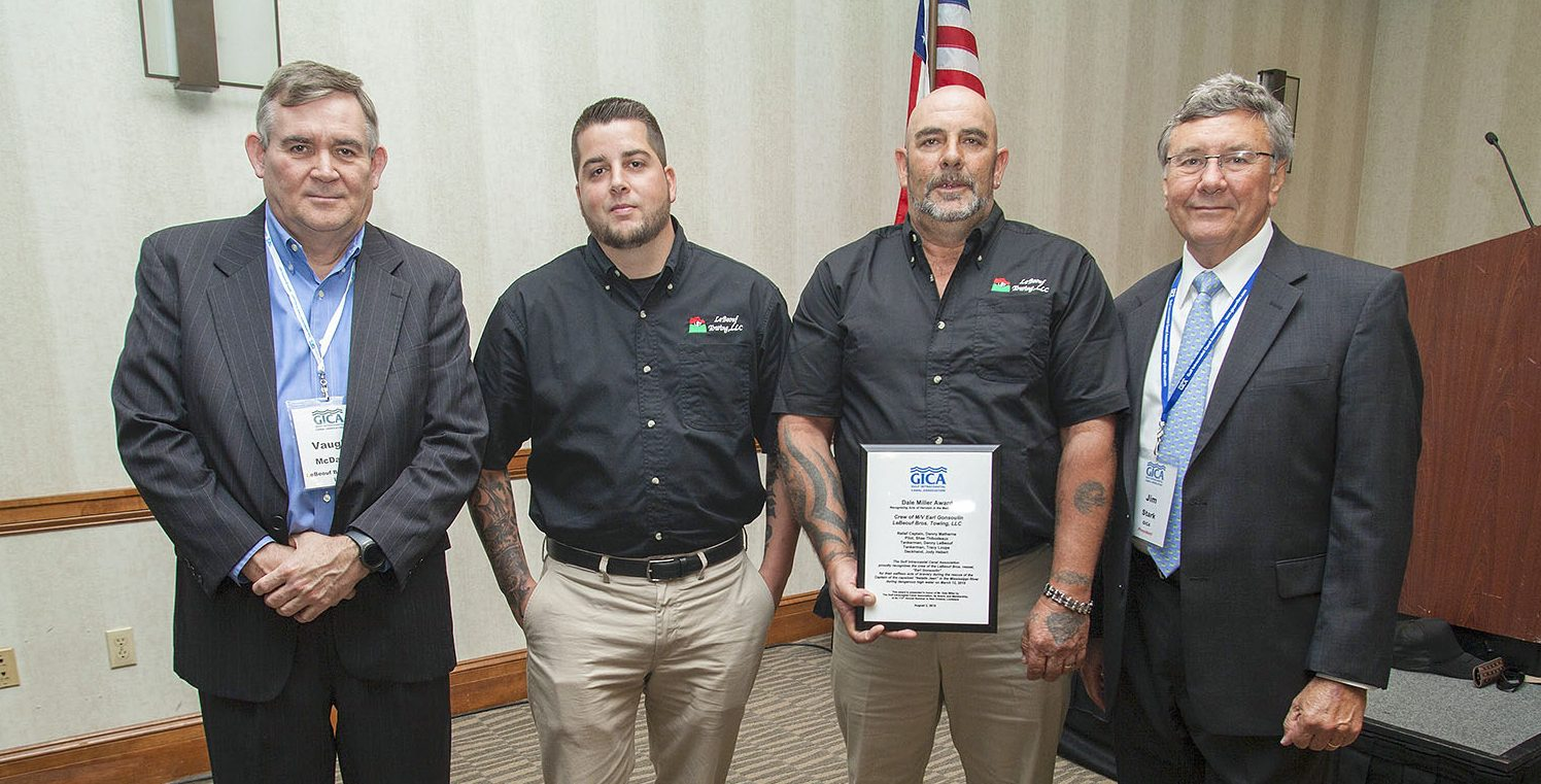 Jim Stark, president of the Gulf Intracoastal Canal Association, recognizes members of LeBeouf Towing for their response to the March 12 sinking of the mv. Natalie Jean on the Mississippi River in New Orleans. Pictured are, from left to right, Vaughn McDaniel, operations manager for LeBeouf Bros. Towing; Shane Thobodeaux, former pilot aboard the mv. Earl Gonsoulin; Danny Mathern, relief captain on the Earl Gonsoulin; and Jim Stark, GICA president. (Photo by Frank McCormack)