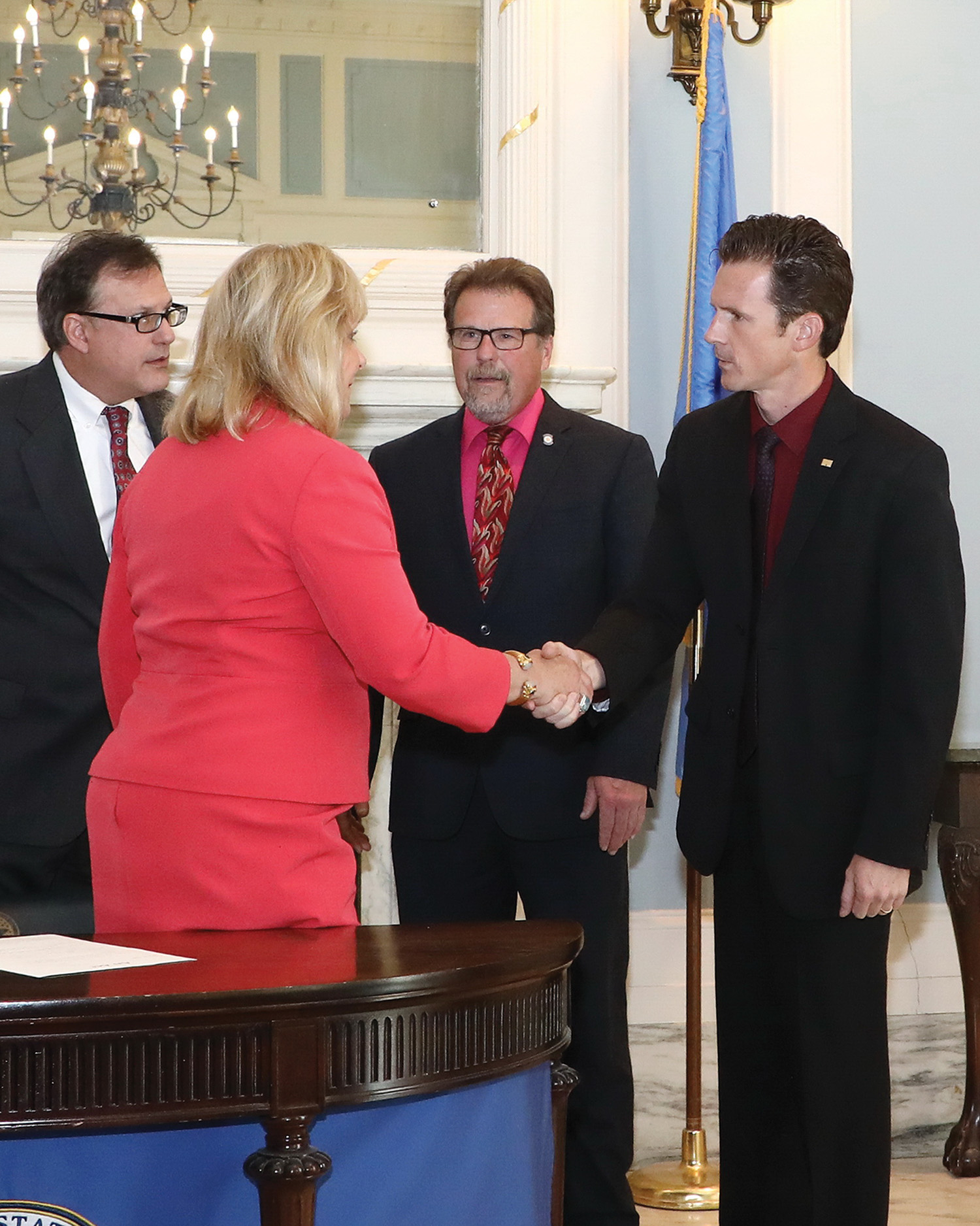 Brad Banks, manager of operations at the Tulsa Port of Catoosa, meets with Gov. Mary Fallin and state representatives for the official bill signing ceremony. (Photo courtesy of Tulsa Port of Catoosa)