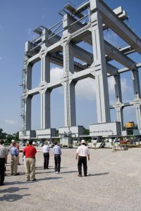 """Super Gantry"" crane specially built for Olmsted construction is the largest in North America; it is 10 stories tall with a lifting capacity of 5,304 tons. It is shown here during an Inland Waterways Users Board visit in 2009. (Photo by John Shoulberg)"