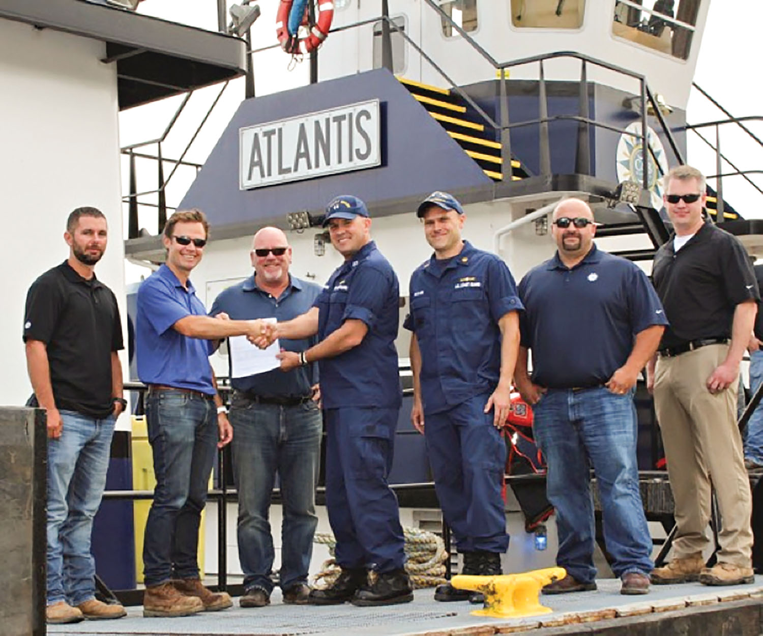 From left, Port Engineer David Westrich; C&B CFO Scott Bray; C&B co-owner Rob Carlisle; Lt. Jim Brendel, supervisor of MSD Cincinnati; CWO Michael McClain, marine inspector, MSD Cincinnati; C&B General Manager Ed Lapikas; and C&B Safety Manager Greg Schabell.