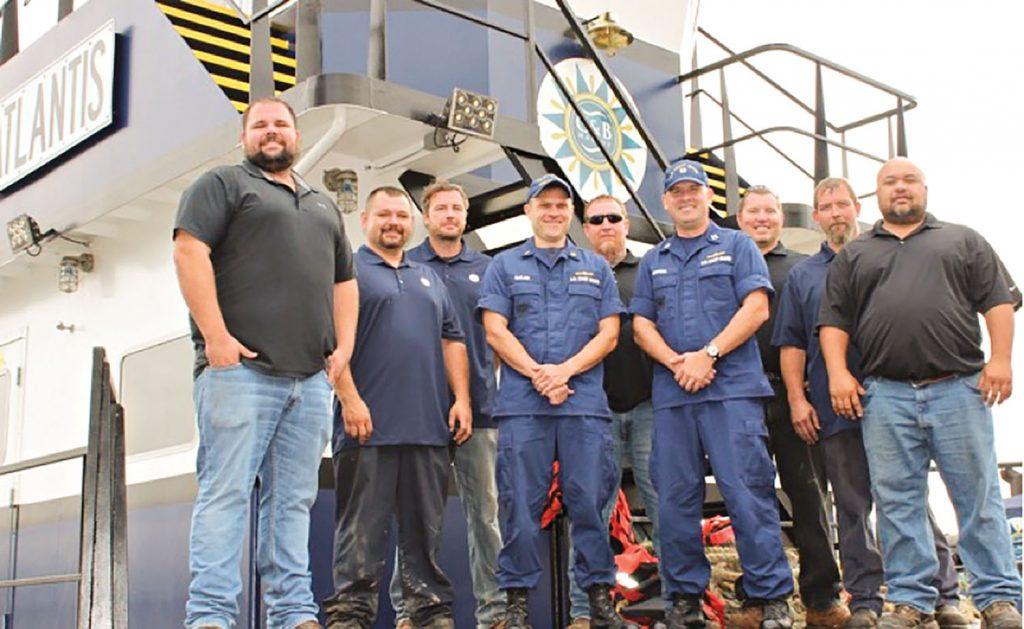 From left, Randal Lapikas, pilot; Ira Baker, mechanic; Joshua Castle, deckhand; CWO Michael McClain, marine inspector, MSD Cincinnati; Lt. Jim Brendel, supervisor of MSD Cincinnati; Greg Chapman, deckhand; Mike McNeely, steersman; Brandon Phillips, lead mechanic; and Jason Inman, pilot.
