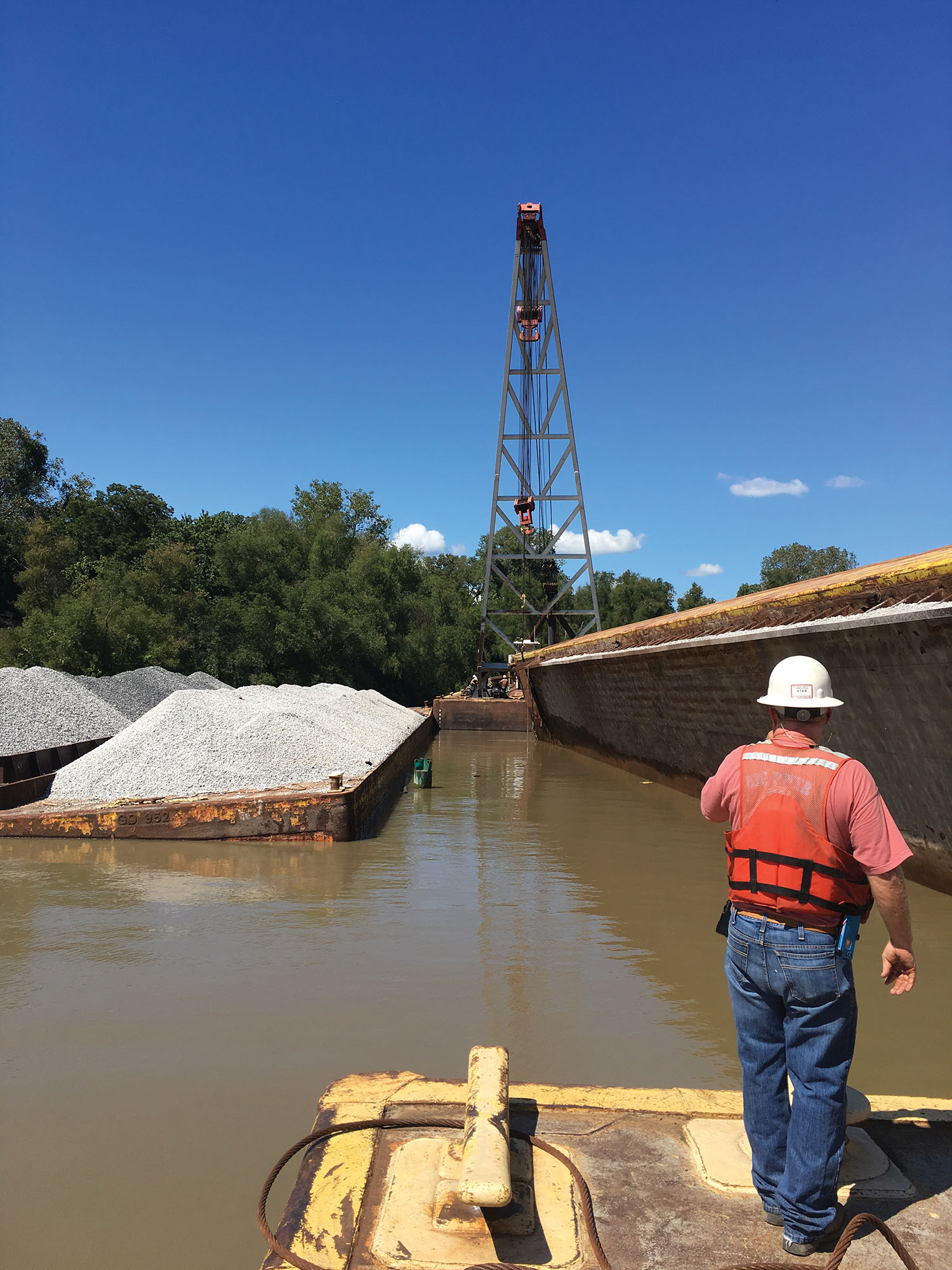 Big River Shipbuilding dispatched a pair of barge-mounted A-frame cranes to the site and successfully flipped the barge and pumped water from its holds on September 16. (Photo courtesy of Big River Shipbuilding Inc.)