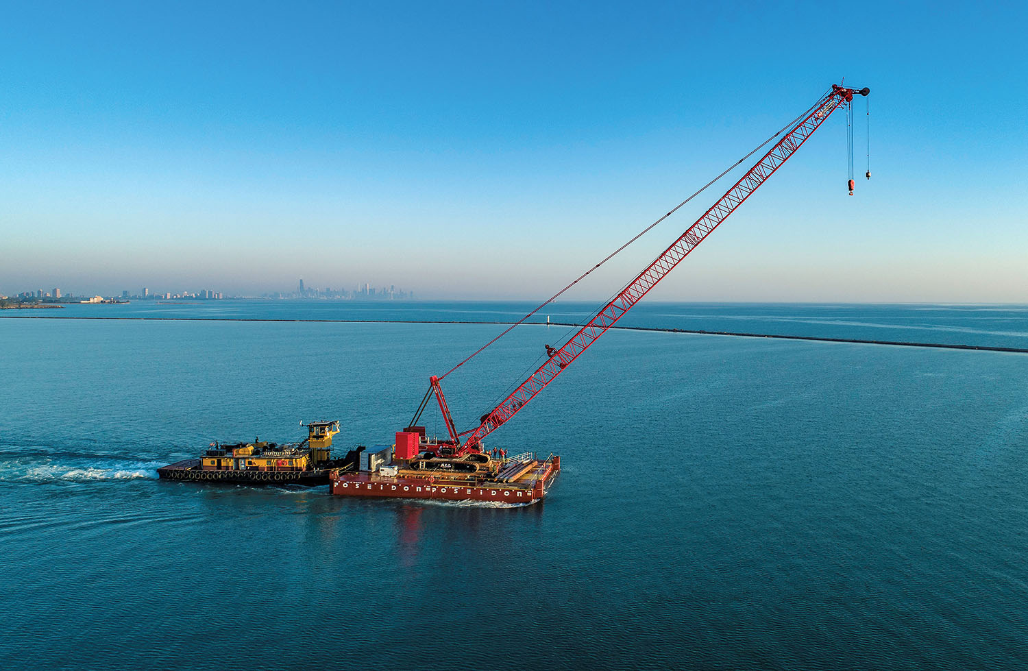 Kindra Lake Towing moved a 300-ton crawler crane from the Calumet Harbor to Chicago Harbor via Lake Michigan on September 15. (Photo courtesy of Jeff Ellis)