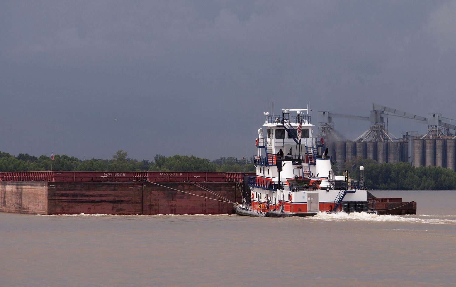 The mv. American Pharoah, part of Turn Service's fleet of towboats, pushes a tow of open hopper barges in the New Orleans area. (Photo by Frank McCormack)