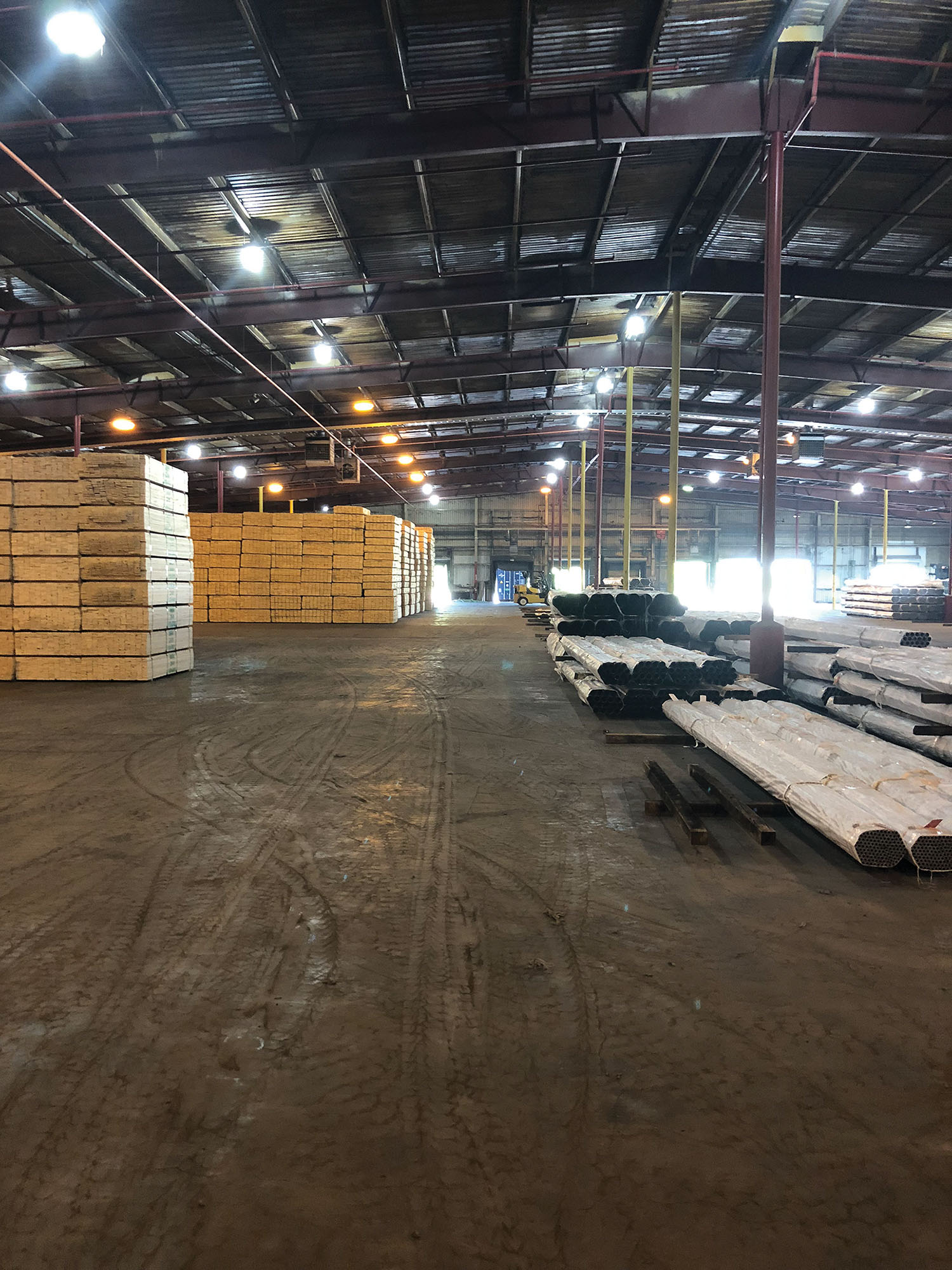 Caption for photo: New facility features 140,000 square feet of warehouse and 10 acres of open laydown area. (Photo courtesy of FML)