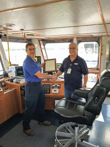 Capt. Ricky Torres and Capt. Tony Economy on the mv. Capt. Ricky Torres.