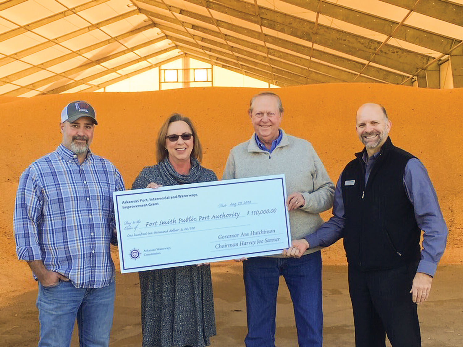 Deidre Smith, director of the Arkansas Waterways Commission, presents ceremonial grant check to Fort Smith Port Authority members Wesley Daniel, Larry Combs and Philip Doss. (Photo courtesy of Five Rivers Distribution)