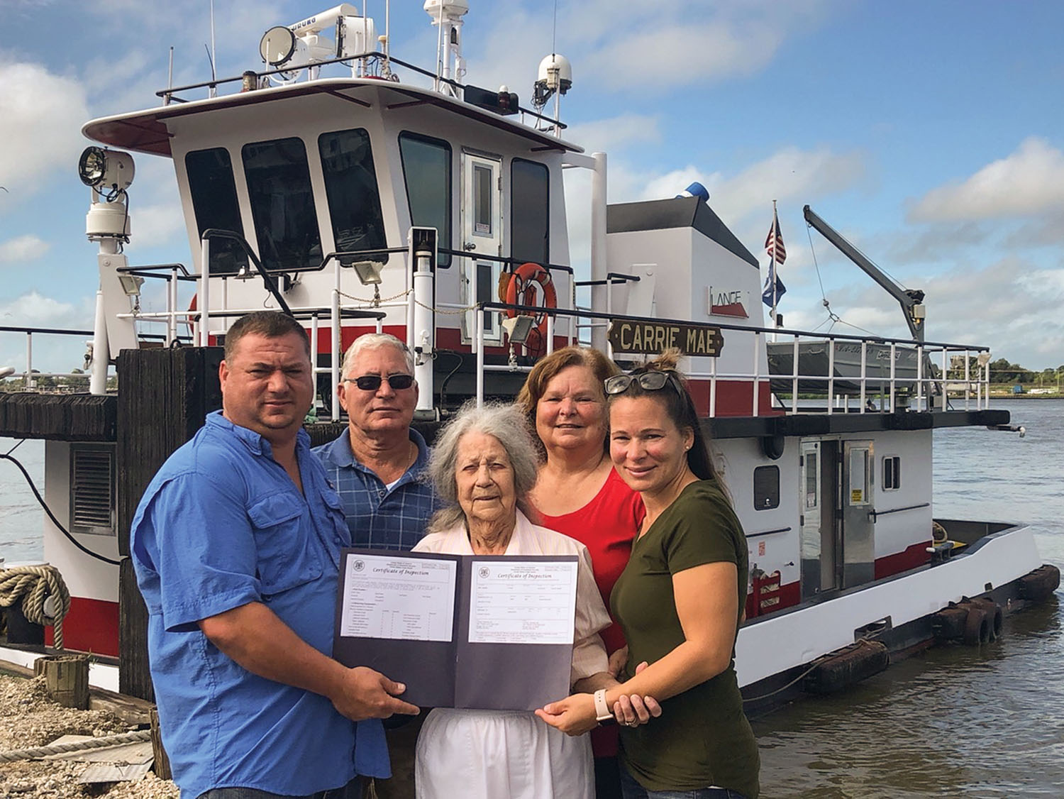Lange Towing owner operators Capt. George Lange Jr. and George Lange Sr.; Carrie Lange, wife of the late Wilbur Lange; Daisy Lange, wife of George Lange Sr.; and KMS Safety's Kimberly Macaluso, daughter of George Lange Sr. (Photo courtesy of Lange Towing)
