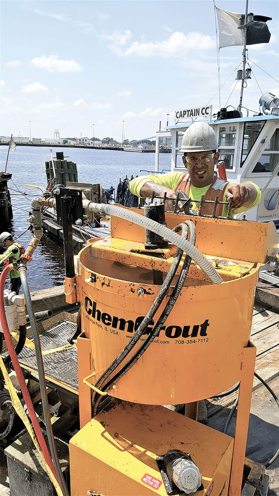 Project Manager Marvin Murphy mixes the grout in preparation for repairing 500 damaged timber piles at an industrial pier in Virginia. (Photo courtesy of FRP Construction/Pilemedic by QuakeWrap