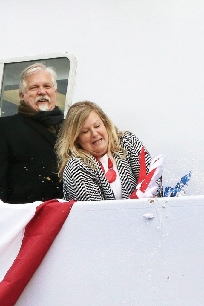 Mary Smith breaks bottle to dedicate vessel named for her husband. (Photo by Jeff L. Yates)