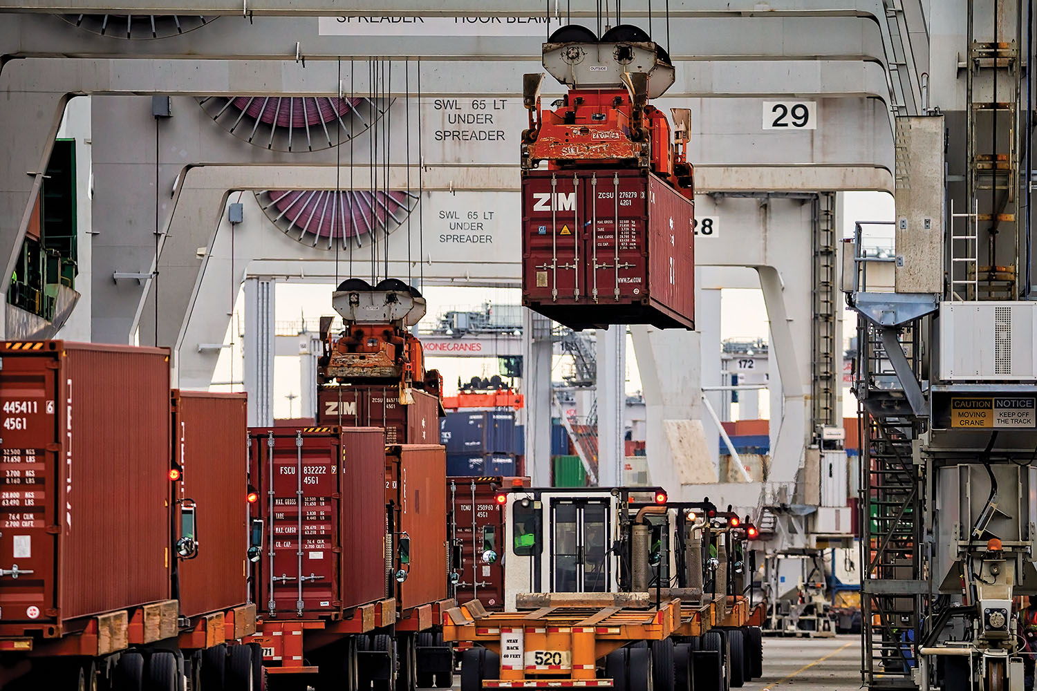 Ship-to-shore cranes load export boxes onto vessels at the Port of Savannah's Garden City Terminal in this February 26, 2018, file photo. The Georgia Ports Authority handled nearly 414,000 twenty-foot-equivalent container units in October. (photo courtesy of Georgia Ports Authority/Stephen B. Morton)