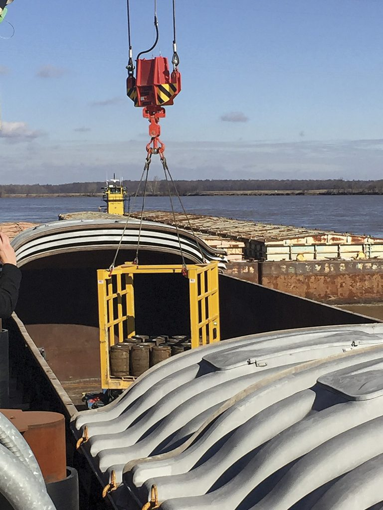 Whiskey barrels are loaded into a hopper barge for trip to New Orleans. (Photo courtesy of Cane Land Distributing Company)