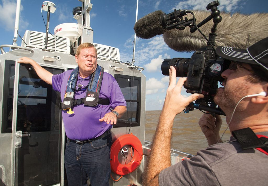 A documentary film maker interviews Port of Morgan City Executive Director Mac Wade on the importance of adequate dredge funding for the port's ship channel. (Photo by Frank McCormack)