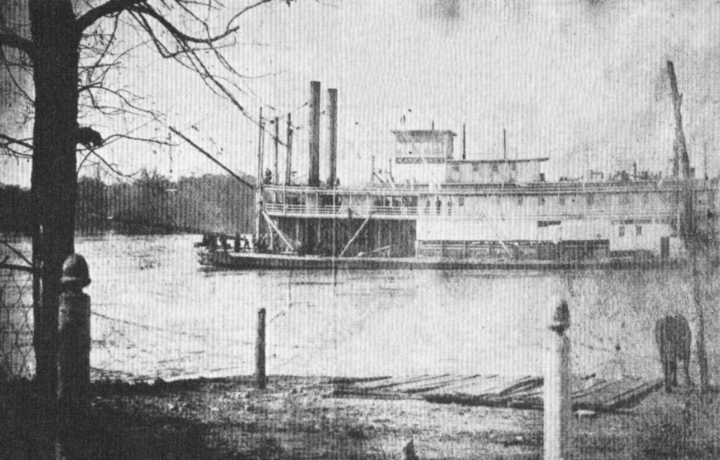 The sternwheeler Mayflower passes Clifton, Tenn., on the Tennessee River, during high water. Note the steamboat acorn finials atop the posts in the foreground. (Keith Norrington collection)