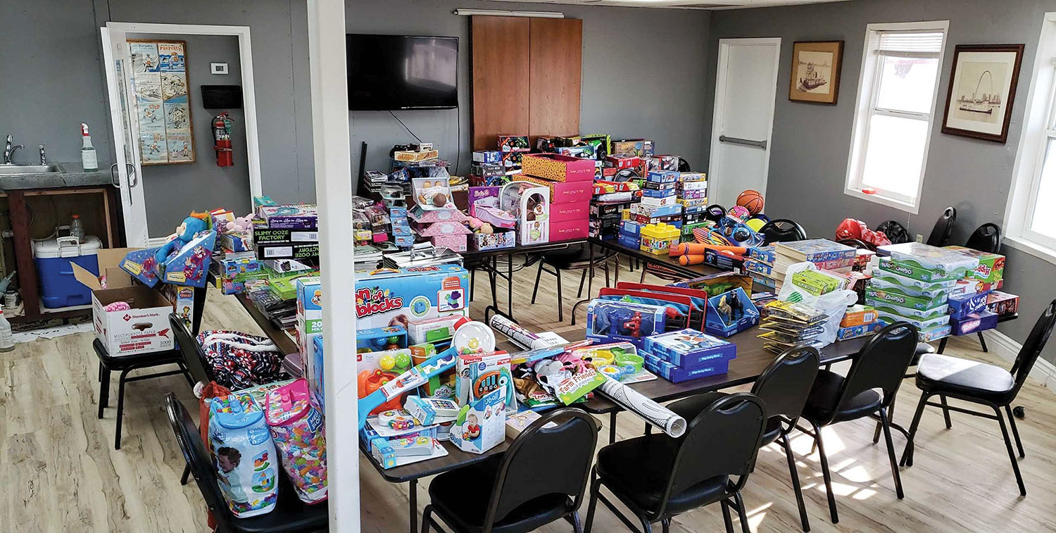 "Osage Marine distributed more than 500 toys that it received from its ""Tug Boats for Tots"" toy drive to local shelters and hospitals."