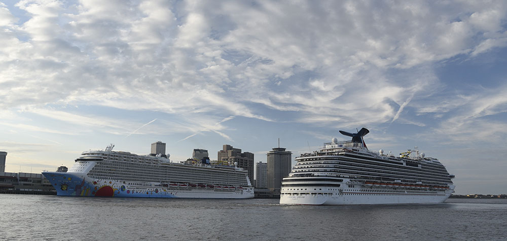 The Carnival Dream departs Port NOLA's Erato Street Cruise Terminal, while the Norwegian Breakaway is berthed at the Julia Street Cruise Terminal. (Photo courtesy of Port NOLA)