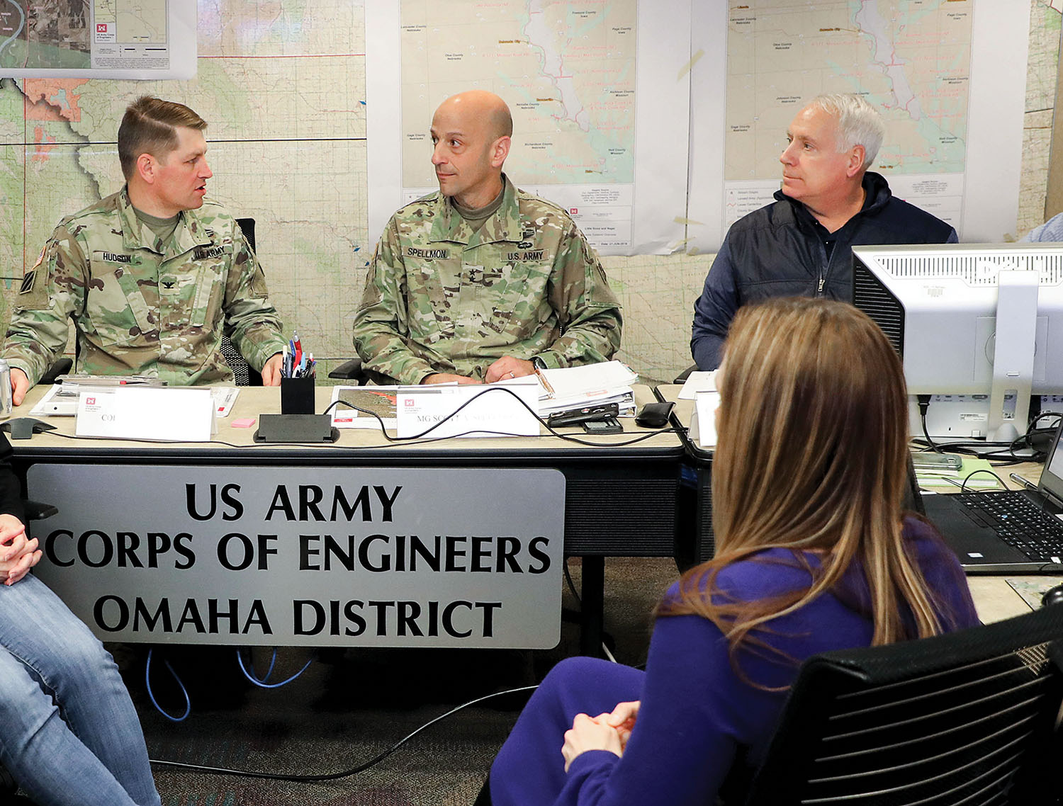 Col. John Hudson (left), commander, deputy commanding general for civil works and emergency operations; Maj. Gen. Scott Spellmon; and Contingency Operations and Homeland Security Director Charles Alexander Jr. receive a briefing on flood fighting in the upper Missouri River basin in the emergency operations center of the Omaha District headquarters March 20. (Photo courtesy of Omaha Engineer District)
