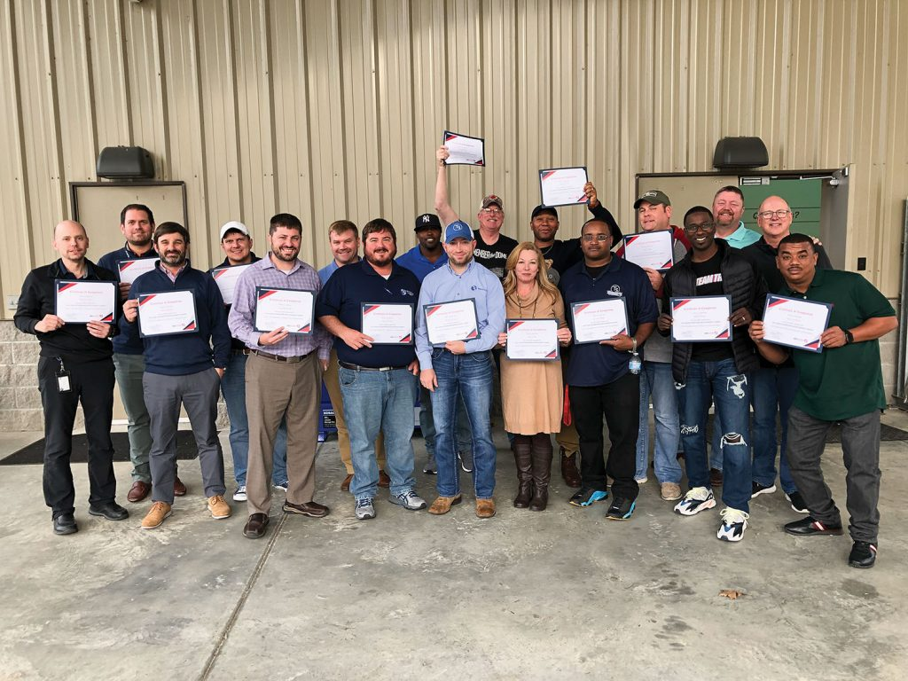 A group of Team Services supervisors celebrates completing the AEU LEAD program.