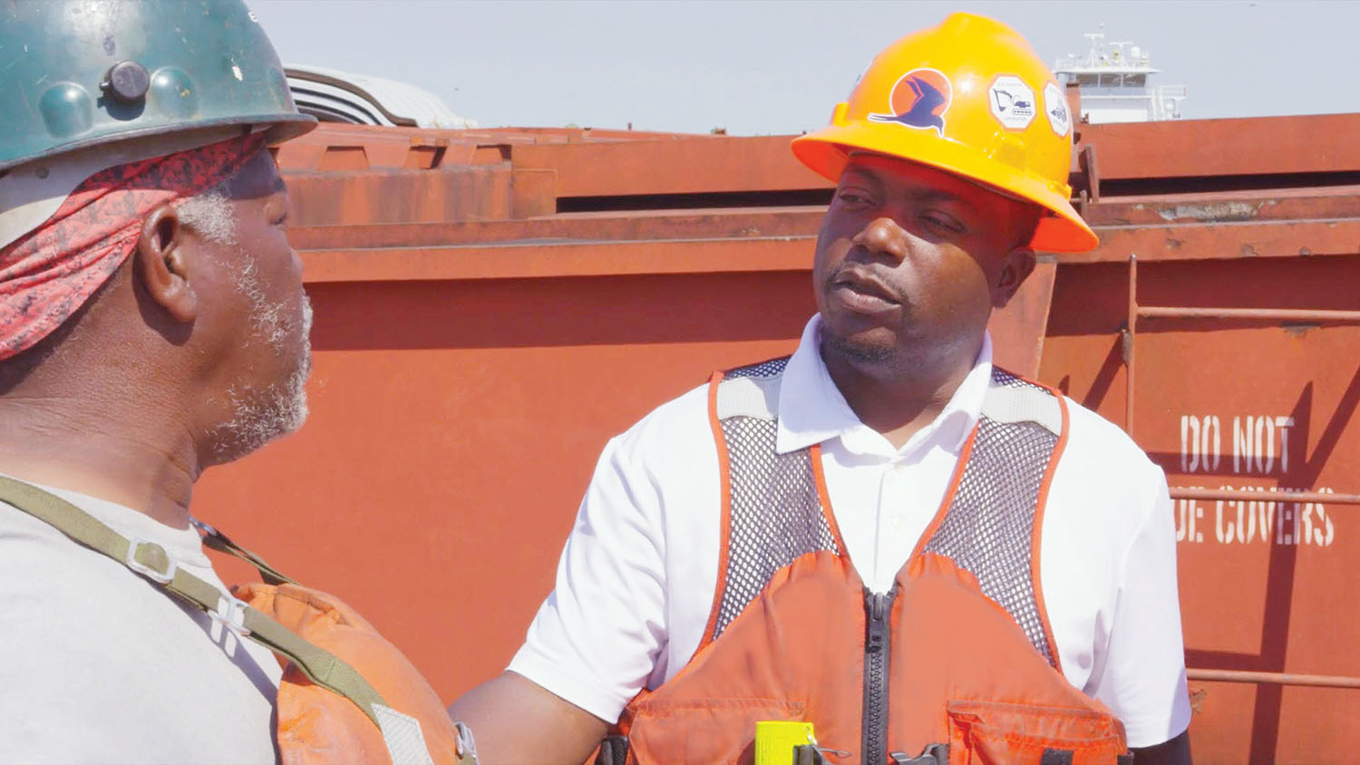 Turn Services Associate Vice President of Fleet Operations Albert Bentley meets with a team member at one of the company's fleet locations.
