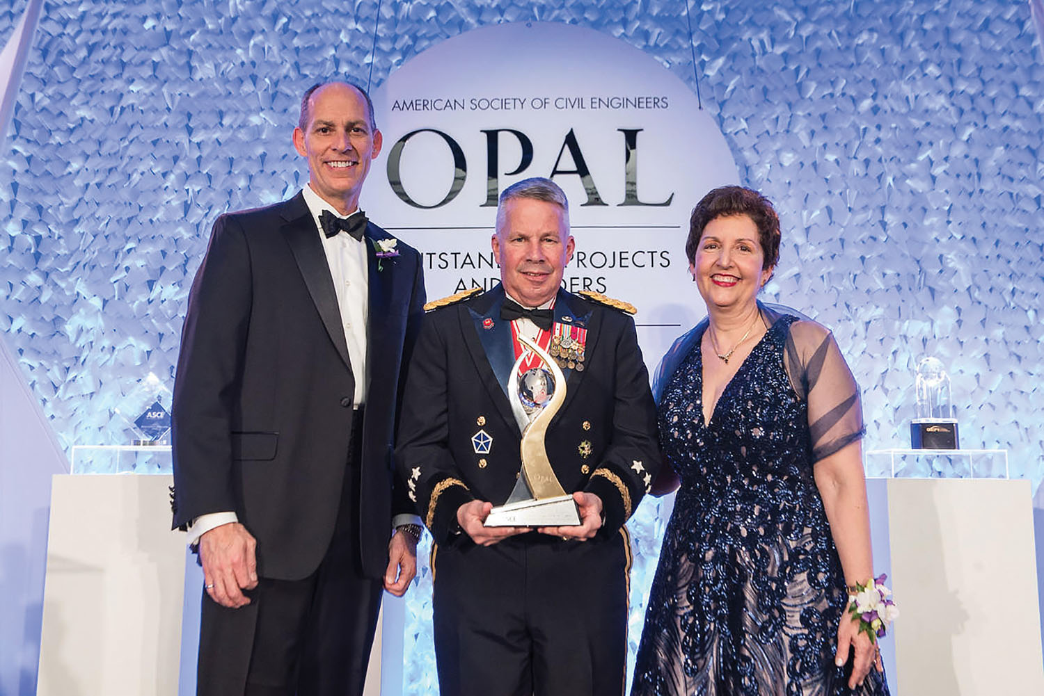 The OPAL award was presented on March 14, during ASCE's annual OPAL Gala in Arlington, Va. Shown: Lt. Gen. Semonite poses with Thomas W. Smith III, ASCE executive director, and Robin A. Kemper, ASCE 2019 president. (Jason Dixon Photography)