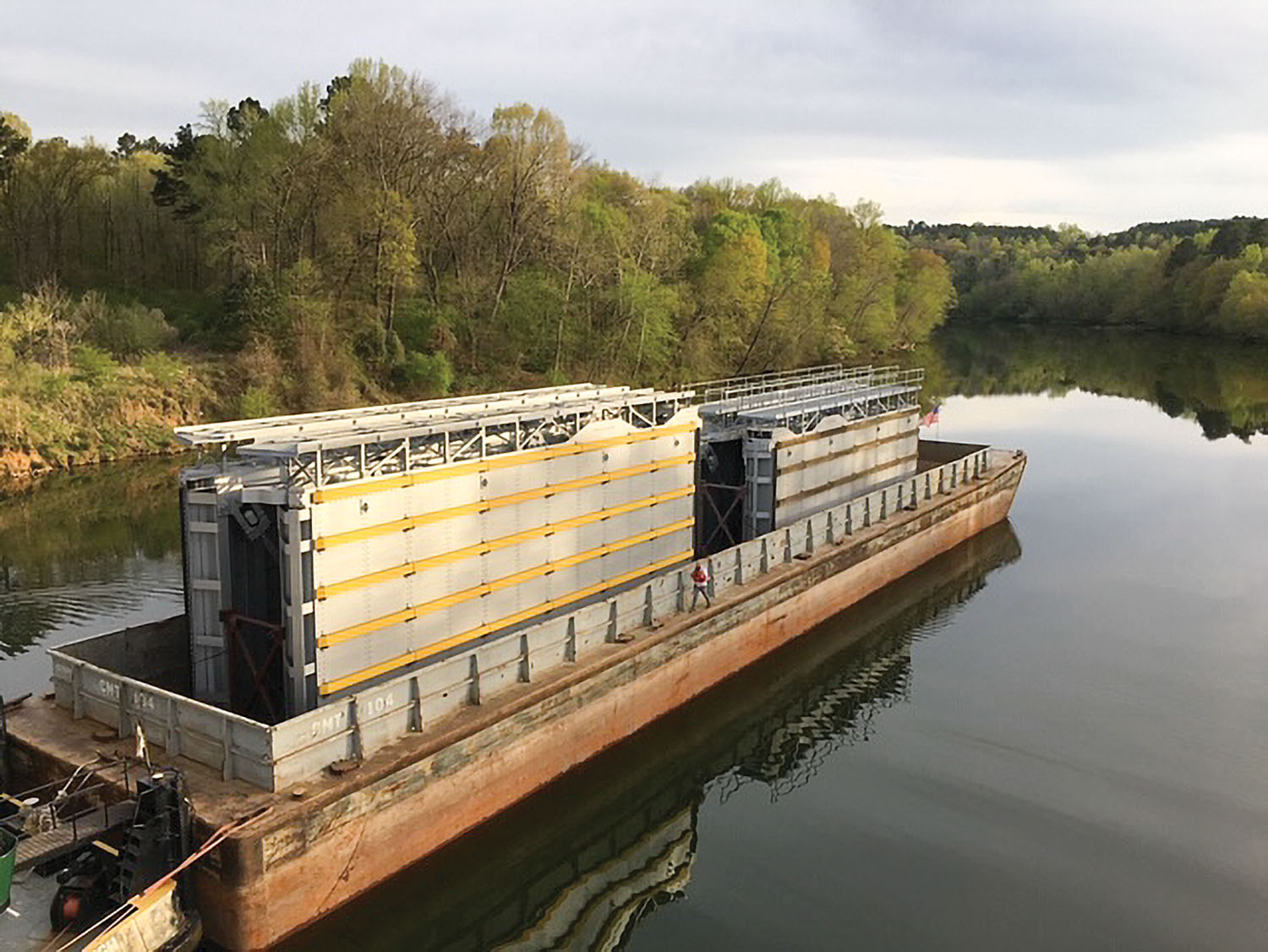 A barge carries new upper and lower gates for Upper Mississippi River Lock 12 on the Black Warrior River near Cordova, Ala. (Photo courtesy of G&G Steel)