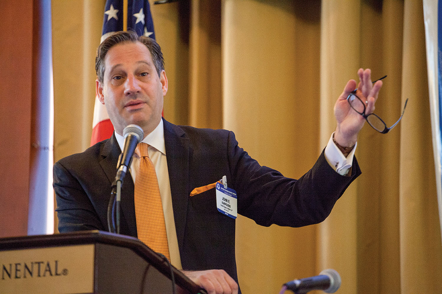 Attorney John Karpousis gestures as he makes a point. (Photo by David Murray)