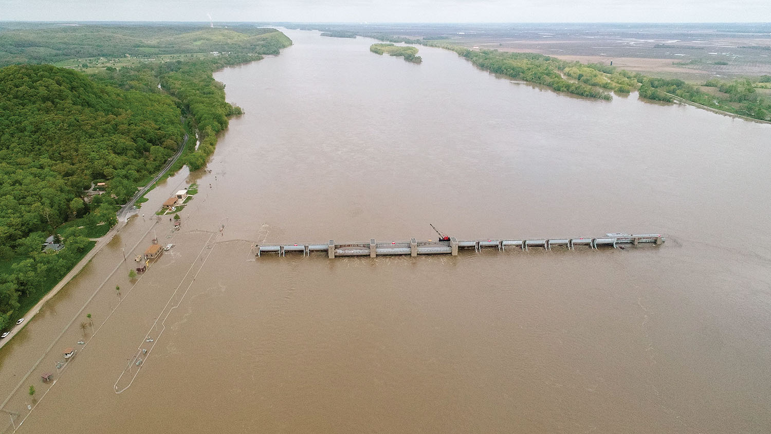 Only the outlines of the lock walls can be seen as Upper Mississippi River Lock and Dam 22 is swamped by floodwater. (Photo courtesy of U.S. Army Corps of Engineers, Rock Island District)
