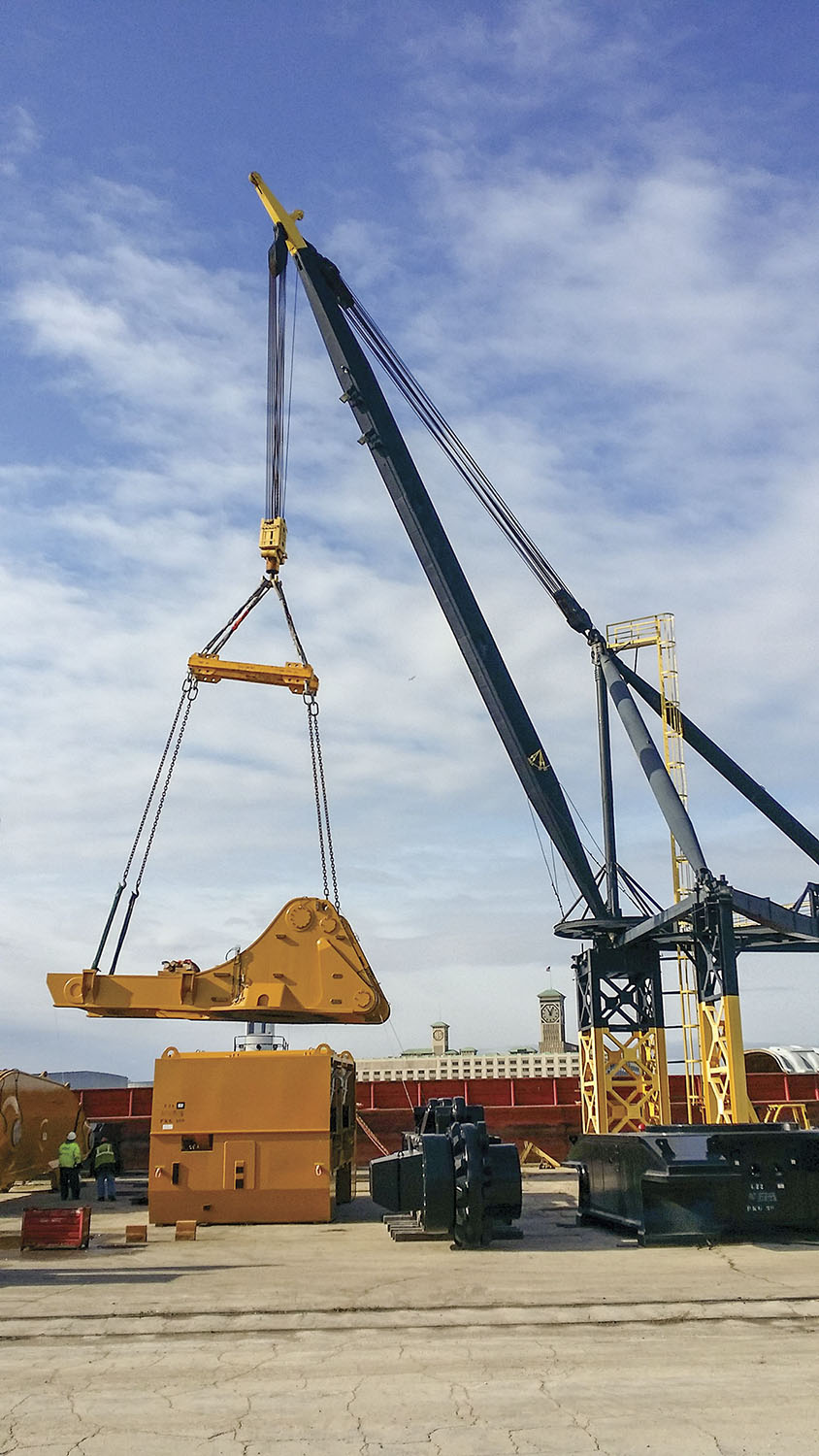 Mining equipment is loaded onto a river barge by Port Milwaukee's 220 ton Stiff Leg Derrick for transit to Houston via the inland waterway system. Port Milwaukee is one of few Great Lakes ports with access to the Mississippi for tug-and-barge service connectivity to Lake Michigan. (Photo courtesy of Port Milwaukee)