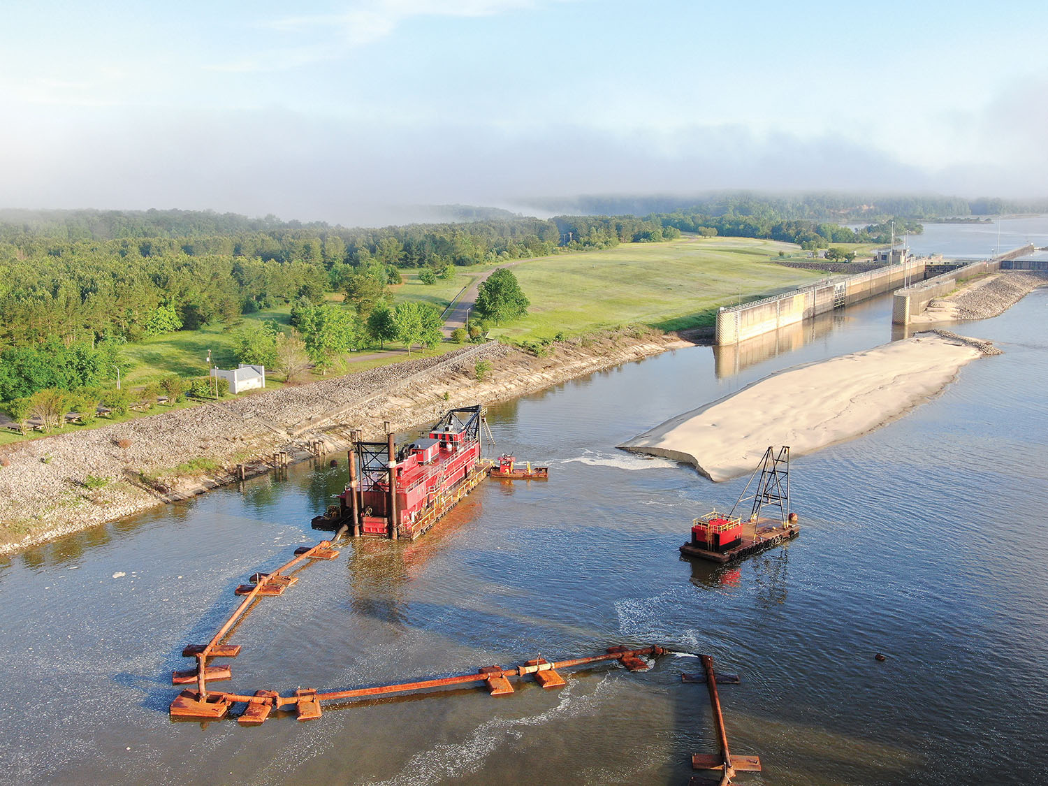 The dredge E. Stroud works to clear the waterway below Aberdeen Lock and Dam. (Photo courtesy of Mobile Engineer District)