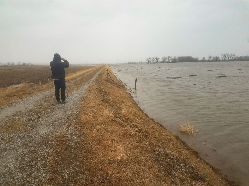 Missouri River water nears the top of levee L611-614 south of Hwy. 34 and Council Bluffs, Iowa, in this photo looking downstream on March 14. A breach was reported in this stretch on March 19. (Photo courtesy of Omaha Engineer District)